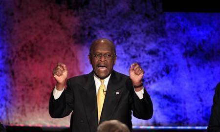 Republican presidential candidate and businessman Herman Cain makes a point while participating in a Republican presidential debate with the other hopefuls at Dartmouth College in Hanover, New Hampshire, October 11, 2011. REUTERS/Adam Hunger