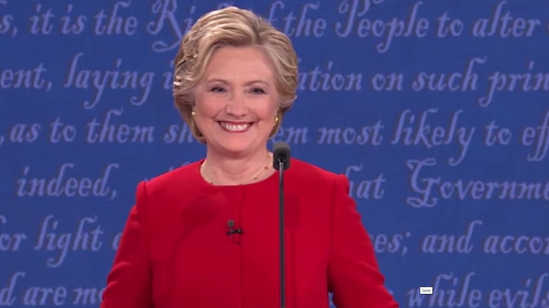 """Donald Trump & Hilary Clinton Presidential Debate Body Language Analysis. Donald Trump says,""""I have much better judgement than she has. There's no question about that,"""" Trump said. """"I also have a much better temperament than she does."""" Clinton responds with,""""Whoo! OK"""" and does a shimmy movement to mock Trump (as if she is shaking him off of herself) while also using it as a way of pacifying the uncomfortable feelings she has. The audience responded with some laughter before Clinton began a point about NATO"""