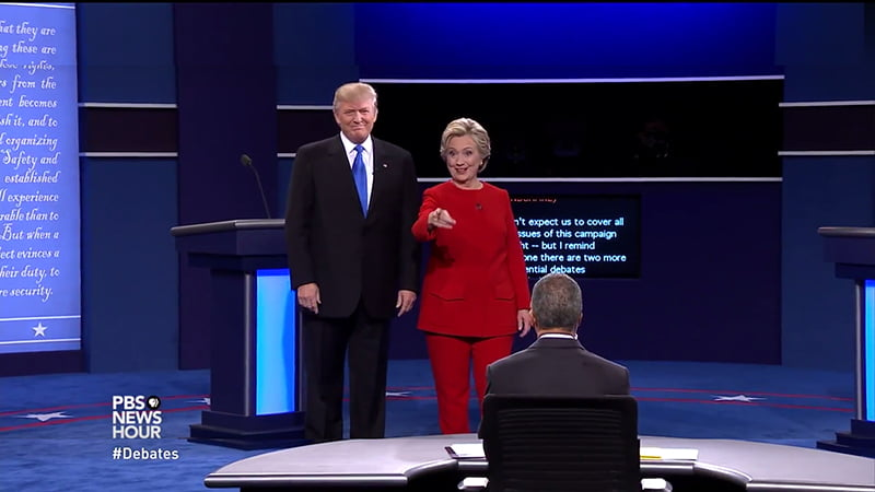 """Donald Trump & Hilary Clinton Presidential Debate Body Language Analysis. Donald Trump says,""""I have much better judgement than she has. There's no question about that,"""" Trump said. """"I also have a much better temperament than she does."""" Hilary Clinton uses a coached technique to suggest she is warm, intimate, approachable and friendly as she 'points to someone in the audience' to indicate she recognizes a fan/supporter or friend. Clinton has used this same technique in large stadiums to create a more intimate atmosphere."""