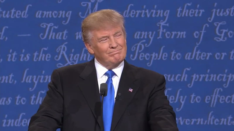 """Donald Trump & Hilary Clinton Presidential Debate Body Language Analysis. Donald Trump reveals a fake smile - a smirk suggesting arrogance and """"I'mm going to get you/defeat you"""" in response to Hilary Clinton who says """"Hello Donald."""""""