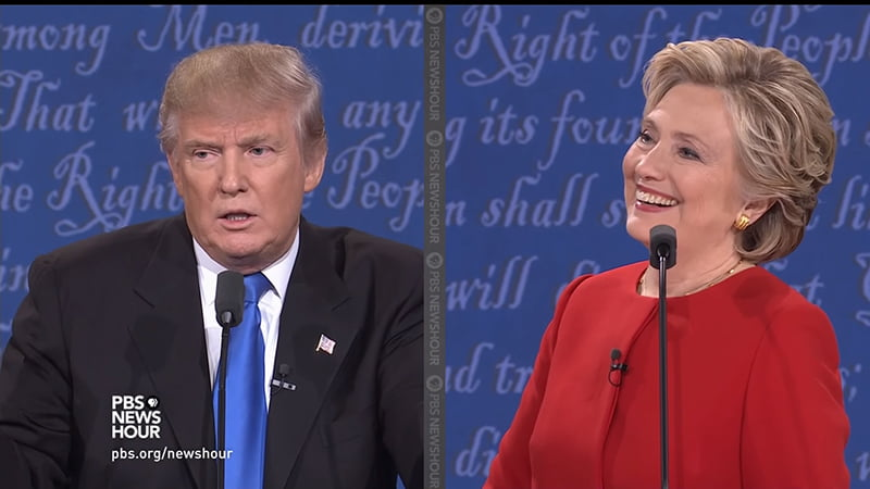 Donald Trump & Hilary Clinton Presidential Debate Body Language Analysis. Donald Trump says Clinton doesn't have the looks or stamina to be president. Clinton turns to face him and smiles and laughs with a head tilt that suggests pride and 'how are you going to get out of this?'