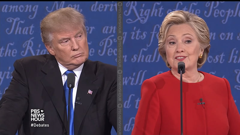 """Donald Trump & Hilary Clinton Presidential Debate Body Language Analysis. Donald Trump says Clinton doesn't have the looks or stamina to be president. Hilary Clinton responds by raising her eyebrows and looking down and turning her head in a gesture that reveals arrogance and pride as if to say """"I got you and I am going to expose you as being bad.'"""