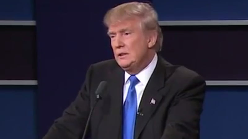 """Donald Trump & Hilary Clinton Presidential Debate Body Language Analysis. Hilary Clinton offers multiple reasons why Trump refuses to release his tax return and, claims his former returns reveal that he paid no taxes. Trump replies """"That makes me smart"""" and then as this close-upshot reveals that he is actually feeling dread at the thought of being exposed."""