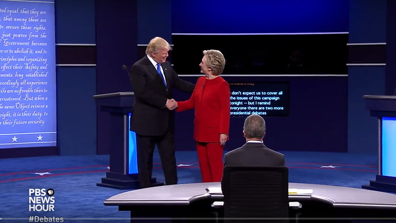 Donald Trump & Hilary Clinton Presidential Debate Body Language Analysis. Hilary Clinton and Donald Trump shake hands and Clinton turns away from the handshake first, indicating that she is more important than him; she ends the shake first.