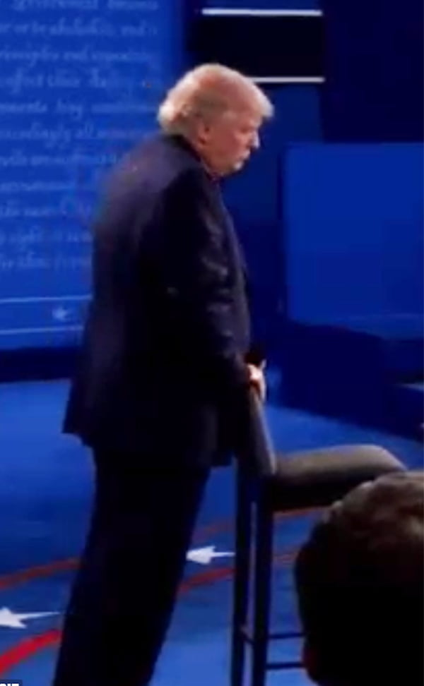 Second US Presidential Debate - Body Language Analysis - Donald Trump thrusts his pelvis back and forth into the back of a chair suggesting either an attempt to pacify anxiety or signaling subconscious sexual intercourse again possibly an attempt to pacify anxiety
