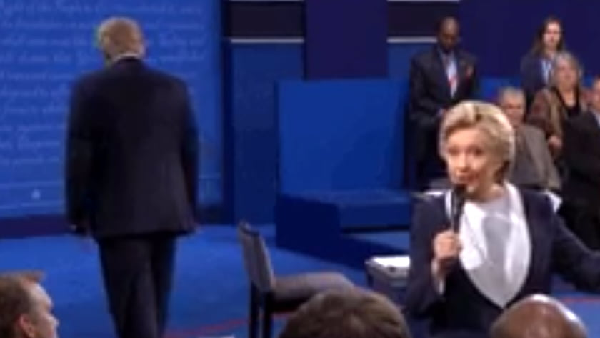 Second US Presidential Debate - Body Language Analysis - Hilary Clinton speaks while Donald Trump paces away from the stage in a gesture that suggests nervousness and a desire to escape. Trump gets bored easily when he is not fully engaged or the center of attention.