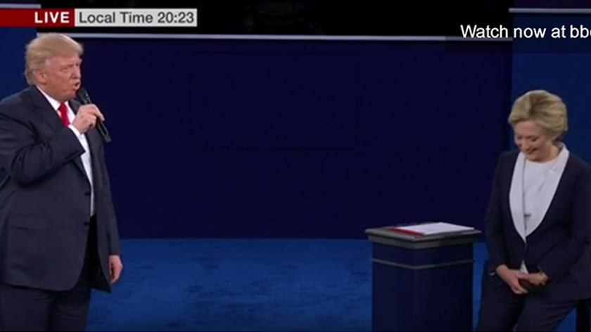 Second US Presidential Debate - Body Language Analysis - Donald Trump begins to scold Hilary Clinton for deleting emails. She begins to stand up from her stool and gazes down possibly in guilt and shame or to plan a rebuttal