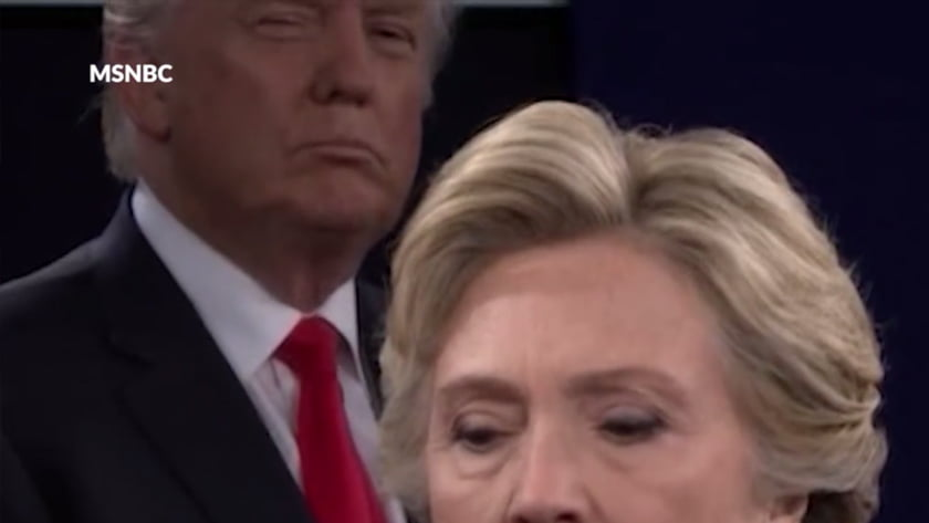 "Second US Presidential Debate - Body Language Analysis - Donald Trump deliberately prowls around the stage and gives Hilary Clinton looks that suggest his power, dominance and distrust of her. This approach suggests he was coached to go on the offensive, attack Clinton and portray her as ""the Devil"" before he used those words to her."
