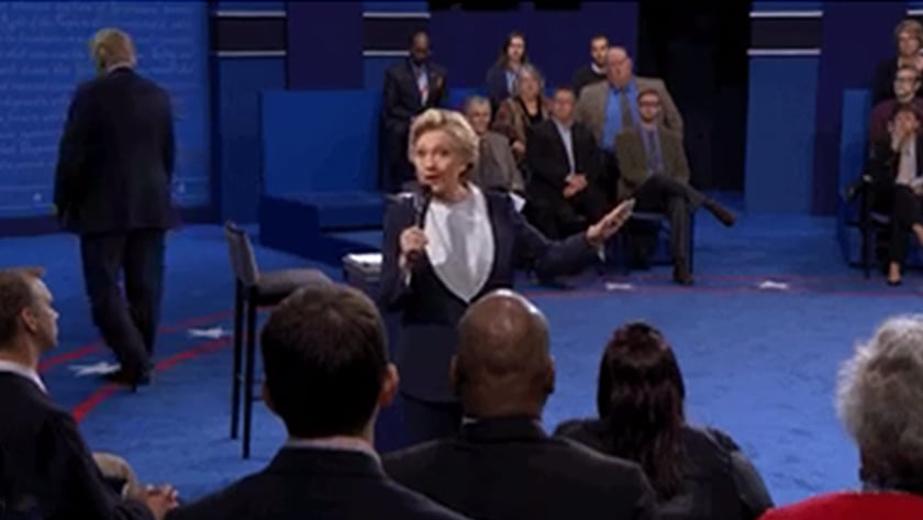 Second US Presidential Debate - Body Language Analysis - Hilary Clinton speaks while Donald Trump paces away from the stage and circles numerous times  in a gesture that suggests nervousness and a desire to escape. Trump gets bored easily when he is not fully engaged or the center of attention